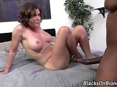 White cutie widely spreads her legs for horny black dude.