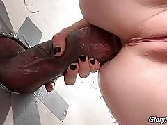 Maddy stuffs black rod in glory hole inside Penny`s craving asshole.