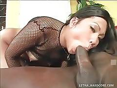 Slutty Asian cutie skillfully works her mouth at big black dick.